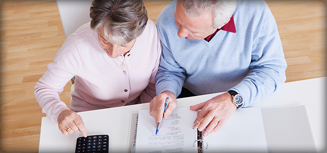 Couple Analyzing Retirement Plan